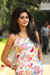 Actress Shamili Stills in Floral Short Dress at Sree Ramaraksha Song Launch 0080