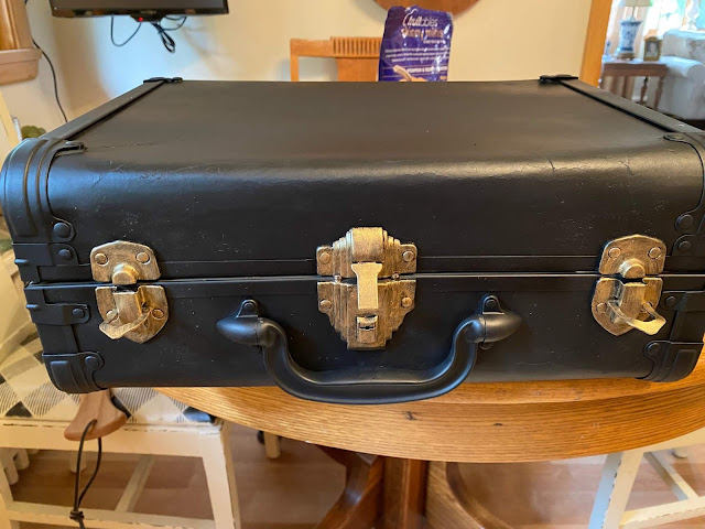 Photo of three suitcase latches painted gold