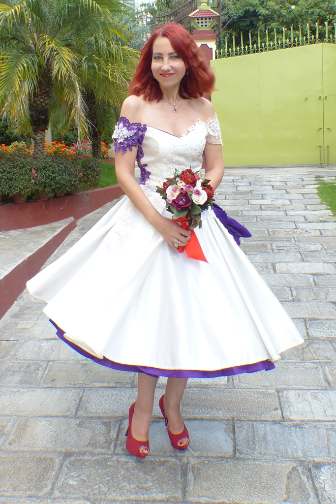 Off the shoulder ivory and purple wedding dress