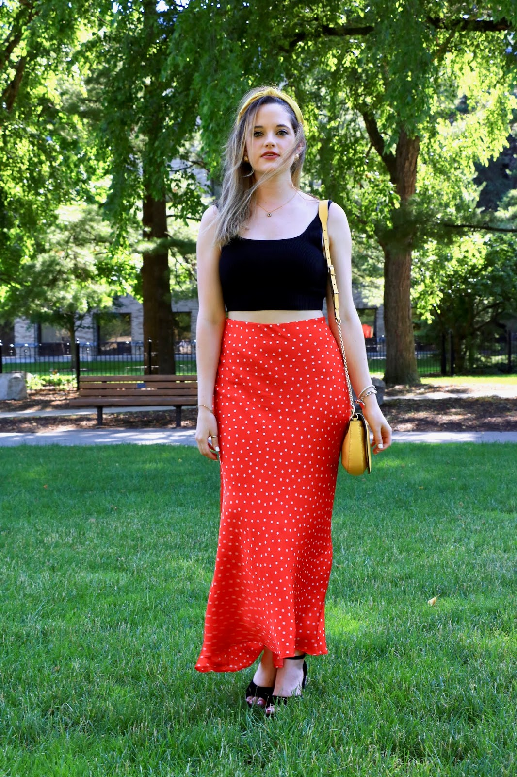 Nyc fashion blogger Kathleen Harper wearing a satin maxi skirt outfit with a black crop top.