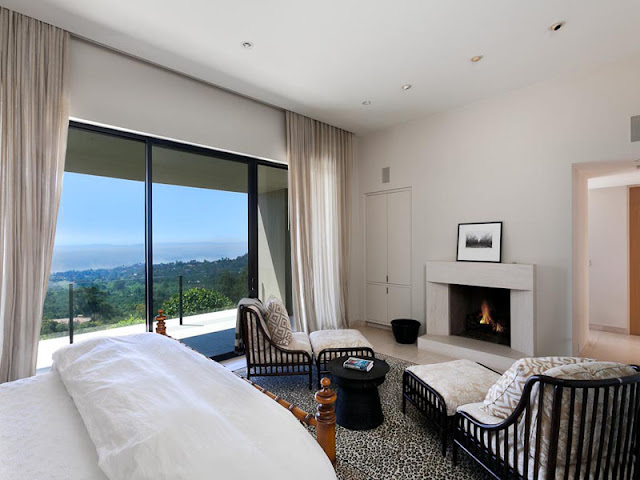 Photo of master bedroom with the fireplace