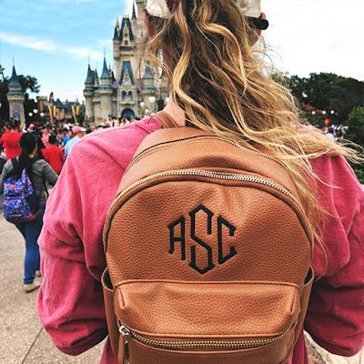 monogrammed mini backpack at cinderella's castle in disneyworld