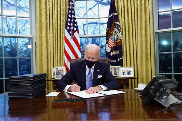 President Biden signs the first of dozens of executive orders that will undo the damage caused by Donald Trump during his four divisive years in office...on January 20, 2021.