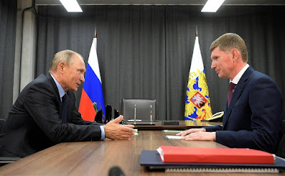 Russian President Vladimir Putin with Acting Governor of Perm Maxim Reshetnikov.