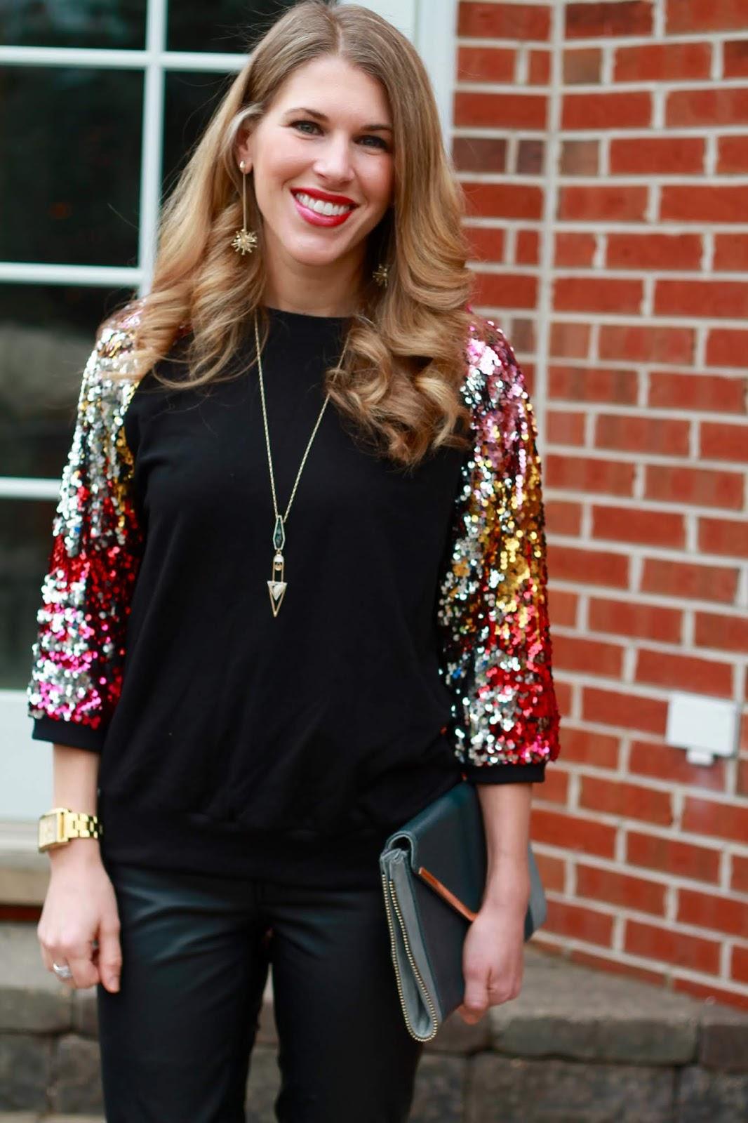 sequin sleeve black top, black leather pants, grey envelope clutch, pink heels,