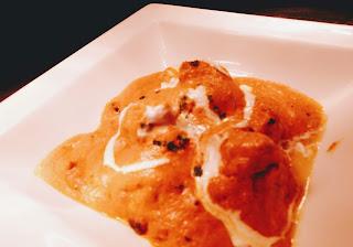 Serving butter chicken (Murgh makhani) in bowl