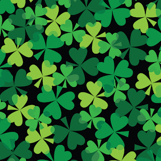 Clipart Image of Green Shamrocks on a Black Background