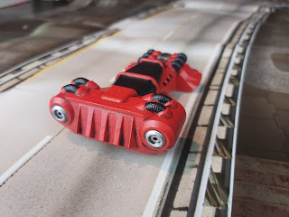 The car drives along the zoomway
