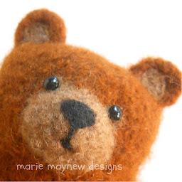 close up of little bear hugs bear