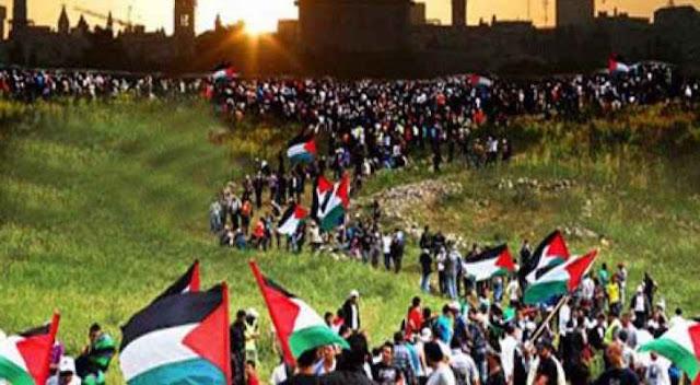 الفلسطينيون ينظمون مسيرات في الضفة الغربية وغزة للتأكيد على التمسك بالأرض وبحق العودة في ذكرى يوم الارض