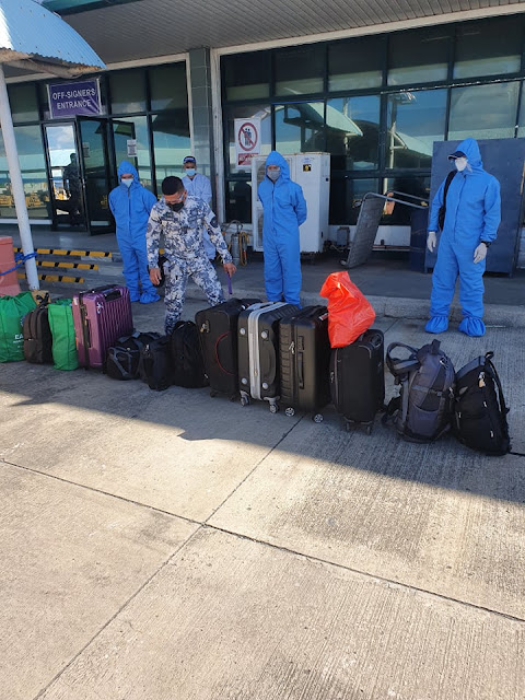 security personnel inspecting baggage of joining seafarers at Batangas Port