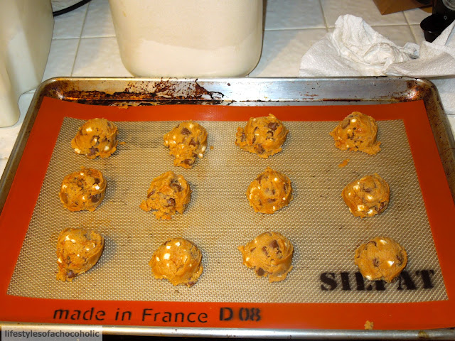 Biscoff Mallow Bit Chocolate Chip Cookies lined on a silpat lined baking sheet before baking
