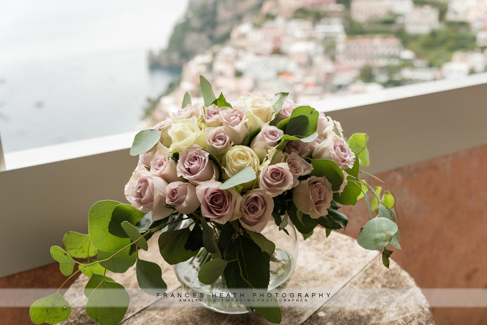 Purple and white roses with eucalyptus