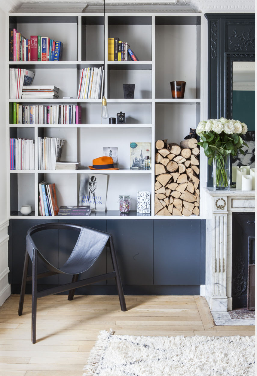 paris apartment with teal color, mid century modern furniture, built in bookshelf
