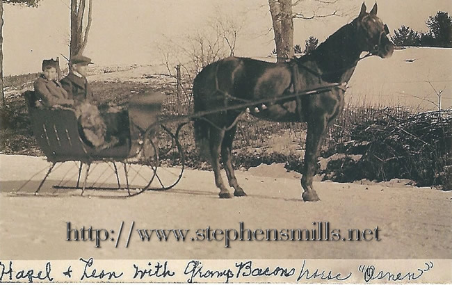 old photo of Hazel and Leon Proctor on sleigh ride with grandpa Hiram Young Bacon's Horse