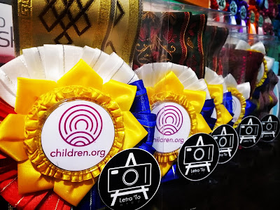 Filipino flag inspired ribbon rosette leis in red, blue, white and yellow color scheme.