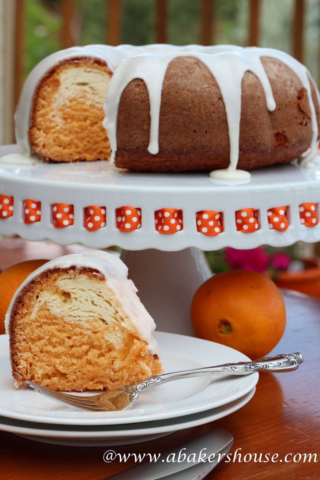 Slice of marbled orange and white bundt cake with white icing