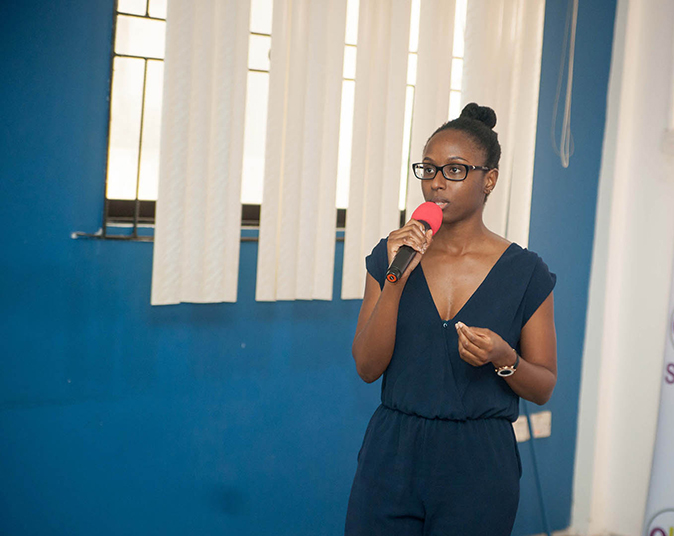 Ire Aderinokun speaking at a tech event