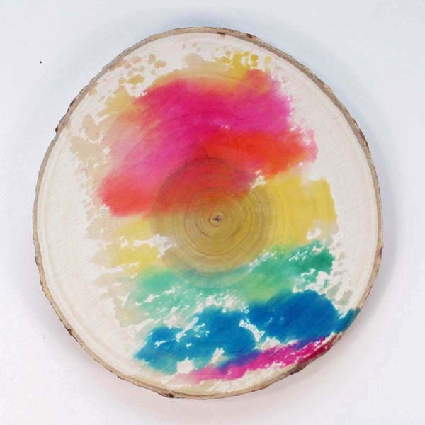Make a rainbow watercolor wash on a wood slice using Tombow Dual Brush pens