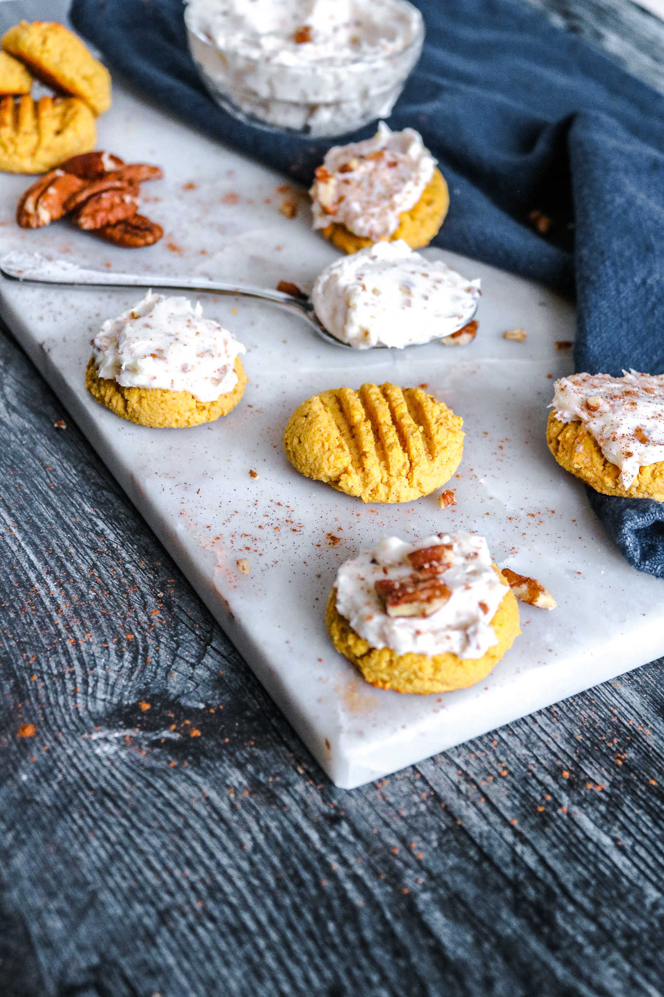 pumpkin cookies with cream cheese and pecan frosting