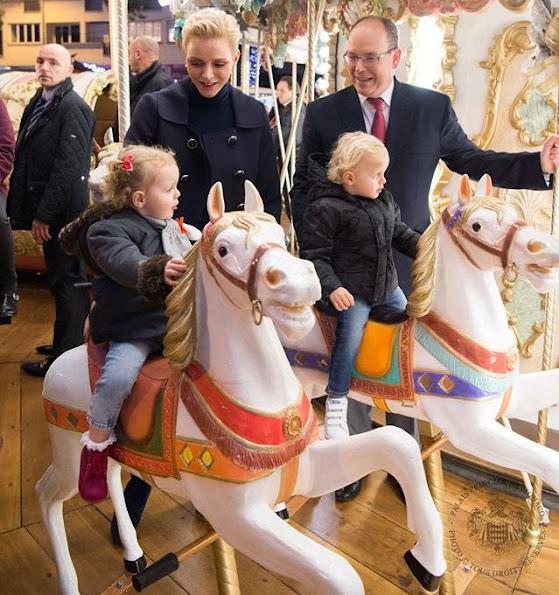 Princess Charlene, Princess Gabriella at Monaco Christmas Village in Monaco. Princess Charlene wears MICHAEL KORS Double breasted wool crepe blazer