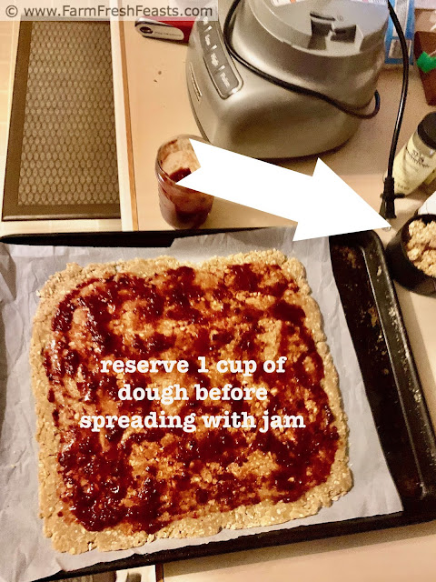 image of making raspberry coconut oatmeal bars--remember to reserve 1 cup of dough before patting the rest onto the baking sheet