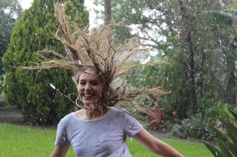 girl happy and shwar on rain