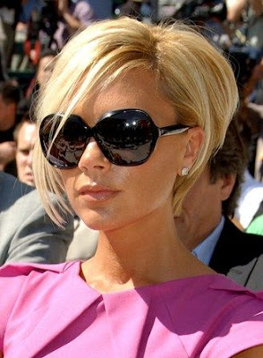 The signature Victoria Beckham look with short bob and blonde hair/via