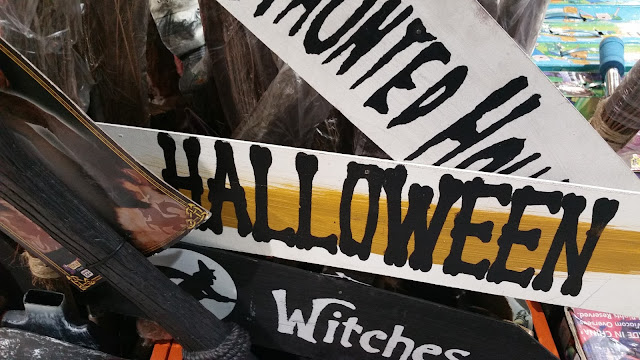 Colorful painted Halloween signs in boards