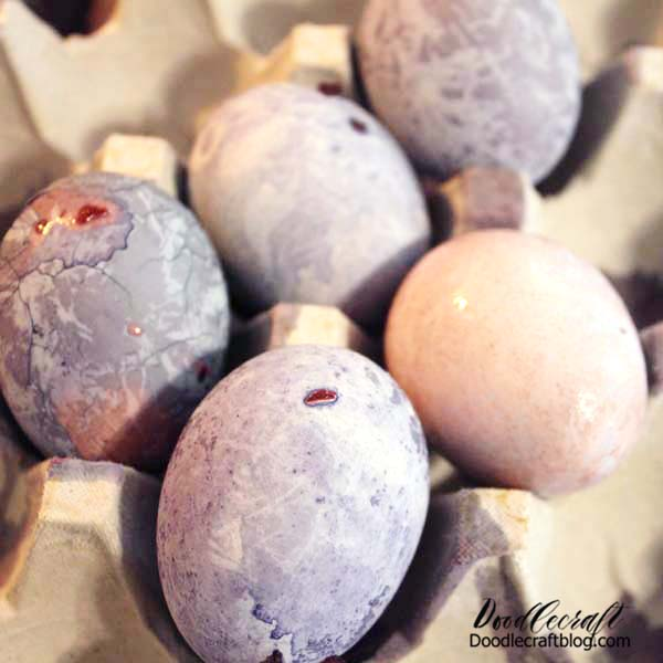 When removed from the flower water, the eggs look pink. The cool part happens when the eggs are allowed to cool down completely. They turn purple or blue and lines, crystalline patterns and textures appear.