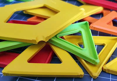 Geomag colour panels hexagon triangle square strewn on table