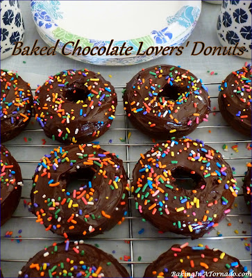 Baked Chocolate Lovers' Donuts are a baked chocolate donut dipped in a dark chocolate glaze. | Recipe developed by www.BakingInATornado.com | #recipe #chocolate