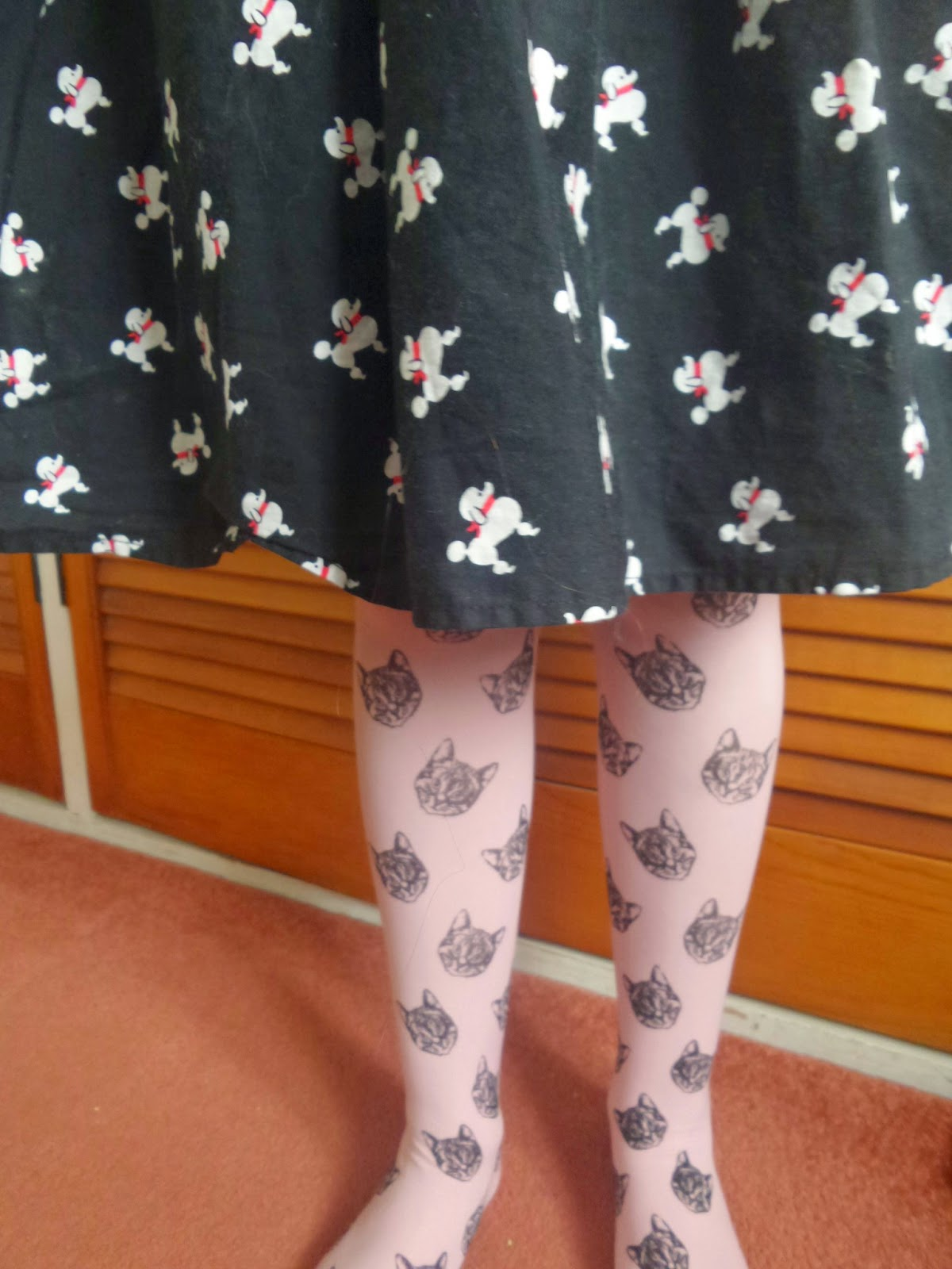Top Ender with Dogs on her skirt and cat heads on her tights
