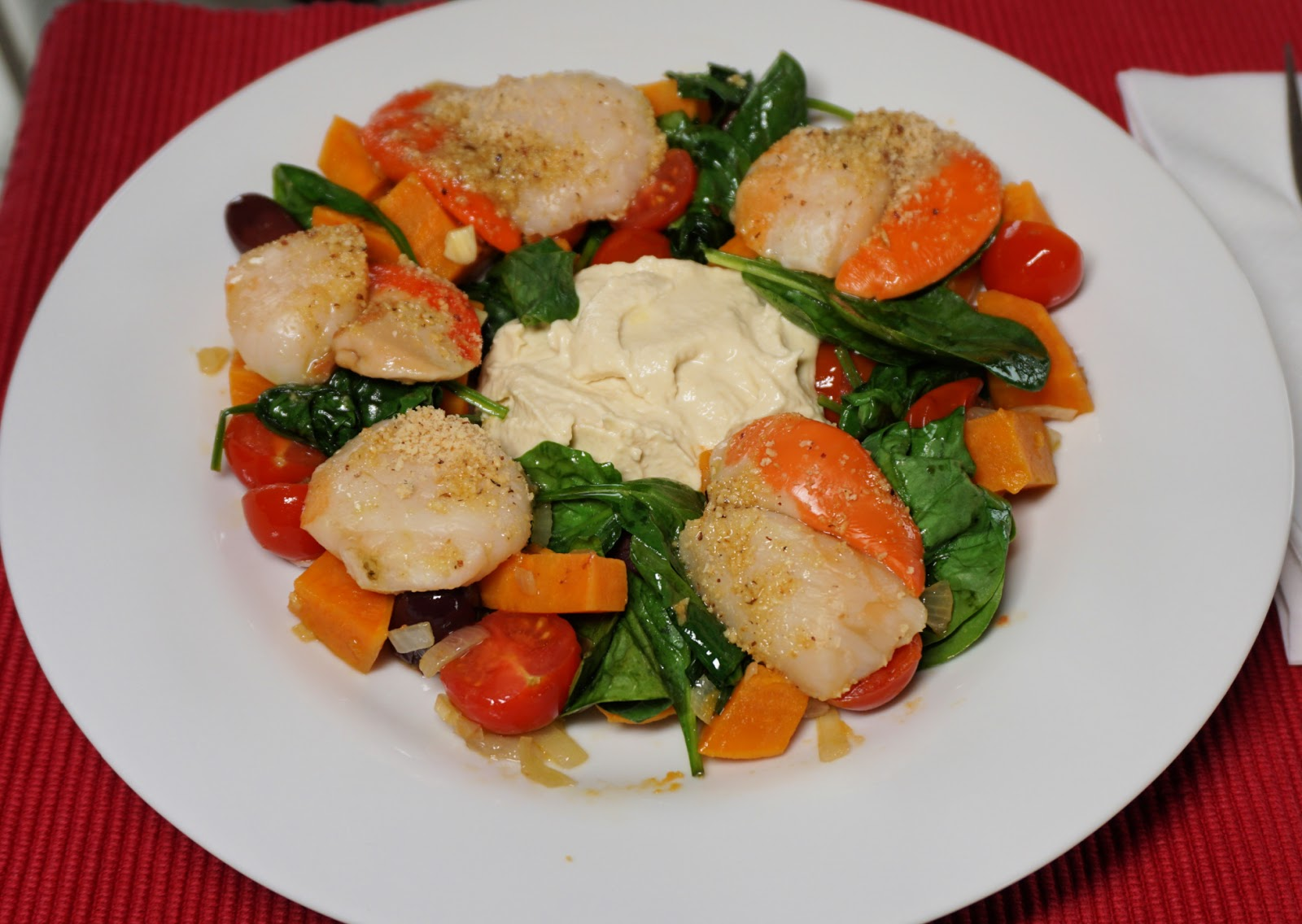 Hummus and scallops on a vegetable bed