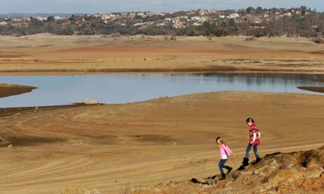 Children walk near the Folsom Lake, California, US, which is experiencing a historic drought. The lake's edge has receded dramatically. (Credit: Rich Pedroncelli/AP) Click to enlarge.