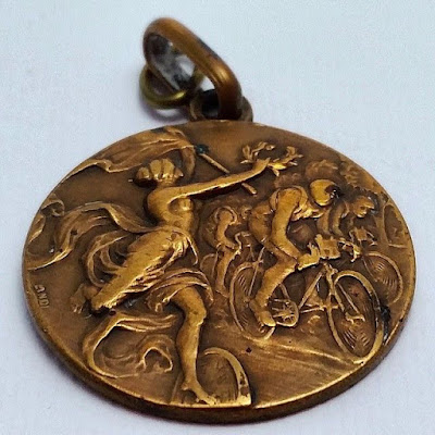 a vintage cycling bronze medal