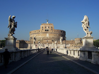 Rome's cylindrical Castel Sant' Angelo seen across the  bridge over the Tiber river