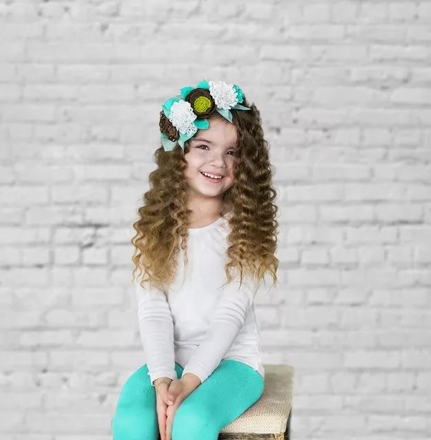 curly hair girl smile