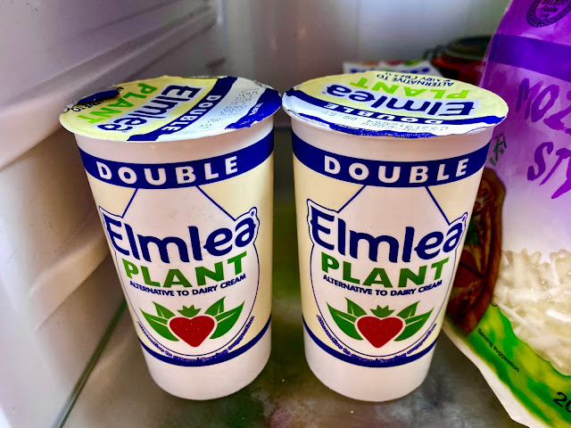 2 pots of Elmea Plant Double Cream alternative to dairy cream on a fridge shelf