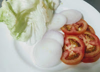 Slice onion, tomato and  lettuce for veg burger recipe