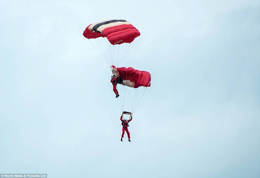 Army Red Devils sky dives get into at middle of the high sky.