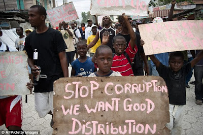 Stop corruption and get distributing the food in Haiti.