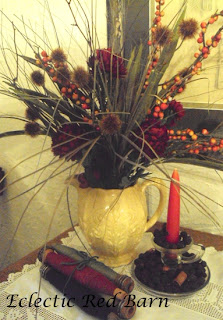 vintage yellow vase, fall flowers, vintage bobbins, candle