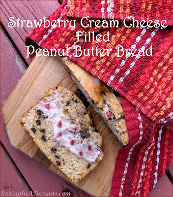 Strawberry Cream Cheese Filled Peanut Butter Bread gets its inspiration from peanut butter and jelly sandwiches. Mini chocolate chips add a little sweetness to the bread and Strawberry cream cheese filling is a fun surprise inside. | Recipe developed by www.BakingInATornado.com | #recipe #bake