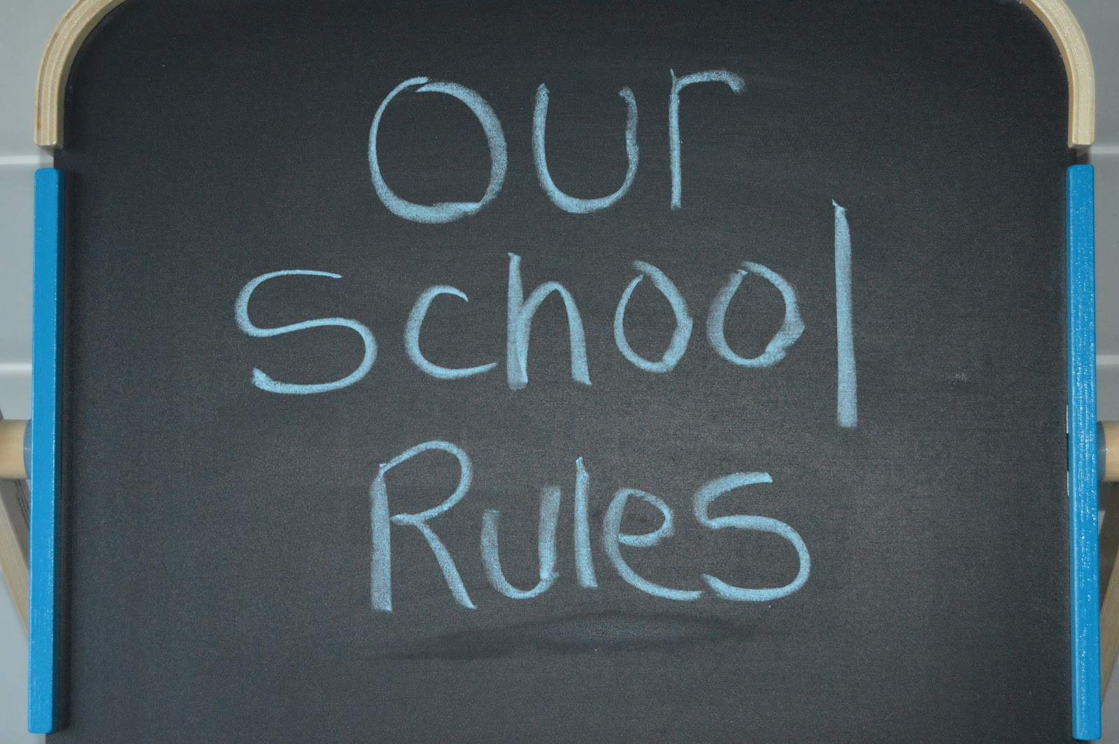 blackboard with 'Our School Rules' written on