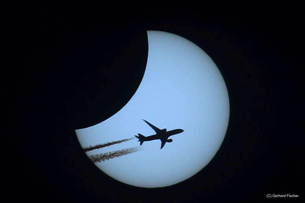 Sun Eclipse with airplaine  2015
