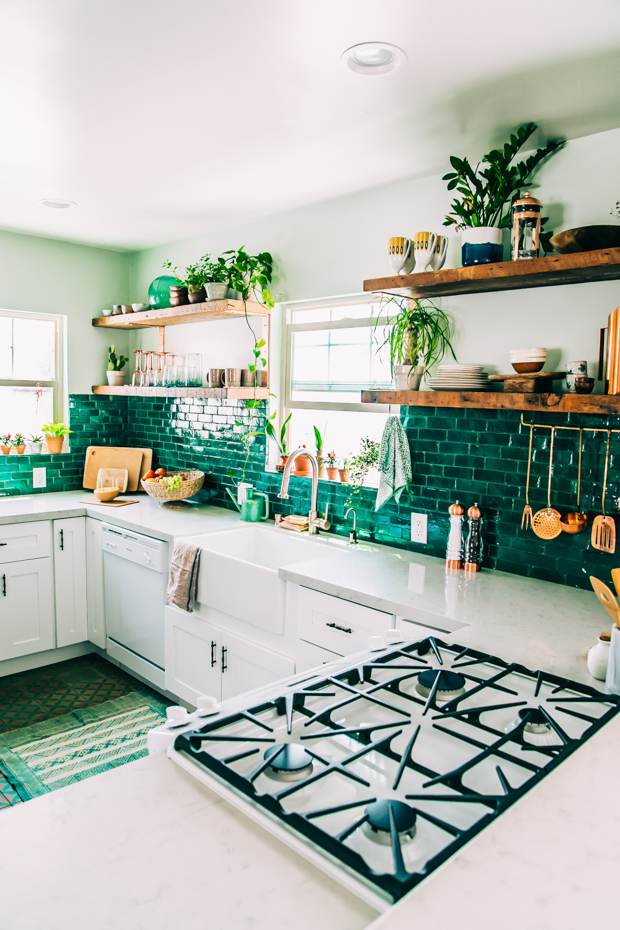 kitchen with green tile backsplash