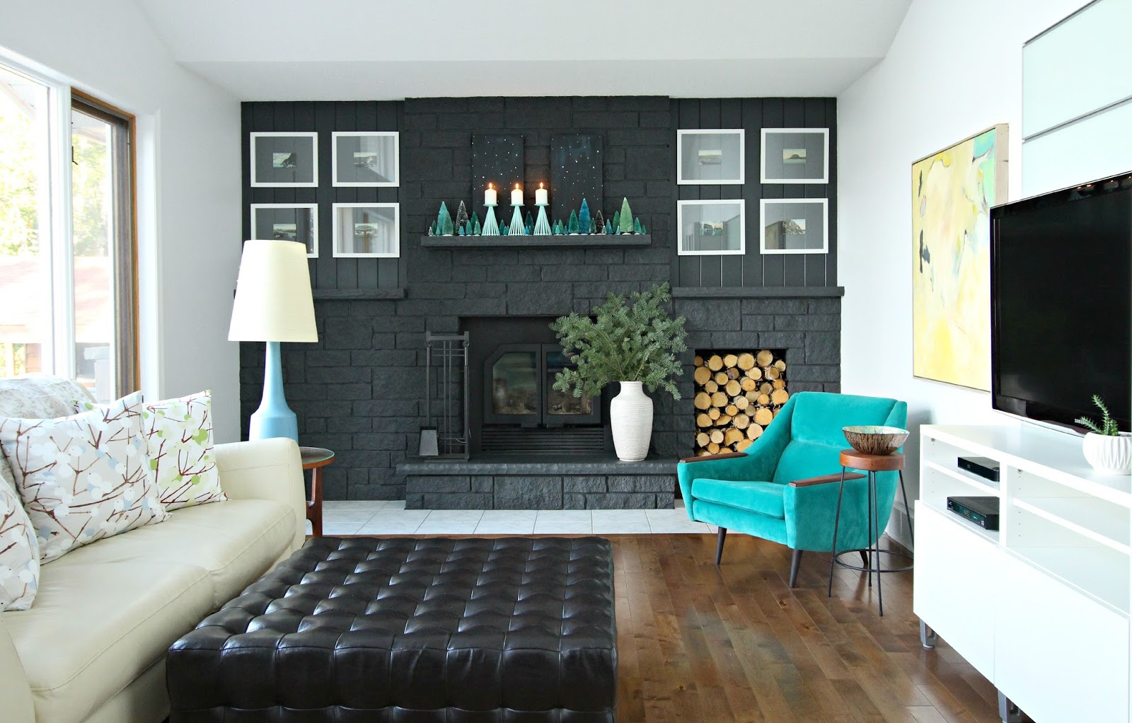 Dark grey fireplace with teal holiday decor