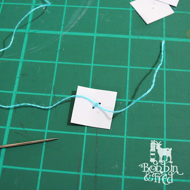 Sew floss to a card square to stick bunting inside of card