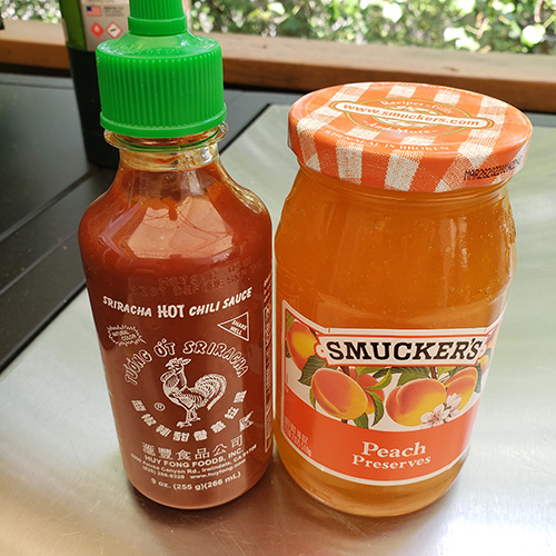 Smucker's Peach Preserves and sriracha sauce are the stars of a spicy sweet bbq glaze.